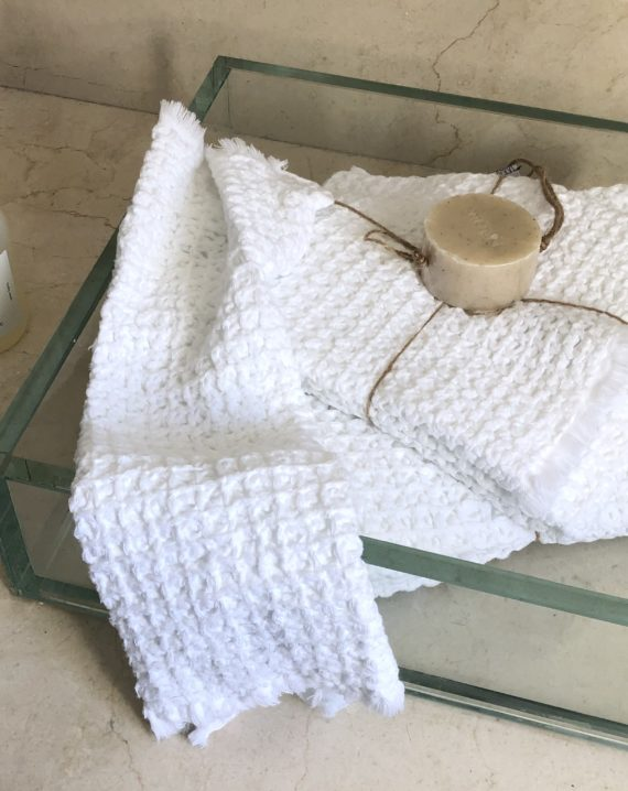 Serviette blanche en coton gaufré
